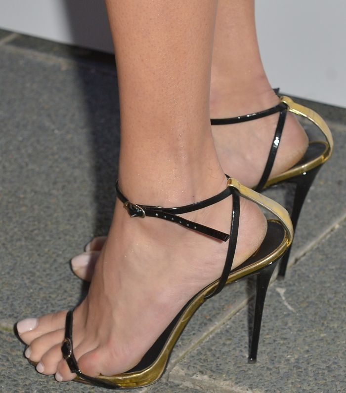 Adriana Lima wearing black and gold leather sandals from Giuseppe Zanotti at her Ocean Drive magazine cover celebration