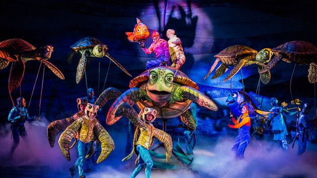 Animal Kingdom....  Marlin and sea turtles with their actor counterparts on stage at Finding Nemo - The Musical