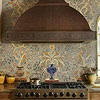 Mediterranean Mosaic  Use your backsplash choice to establish your kitchen's style. Here, a marble mosaic incorporates Mediterranean colors and patterns in a trompe l'oeil creation, complementing the Tuscan-style home's old-world look.
