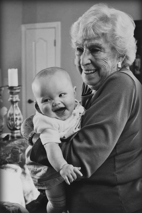 black and white baby picture with Grand Ma  baby smile