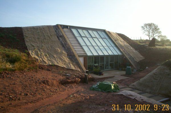 Earth sheltered homes in the process of building for Building earth sheltered homes