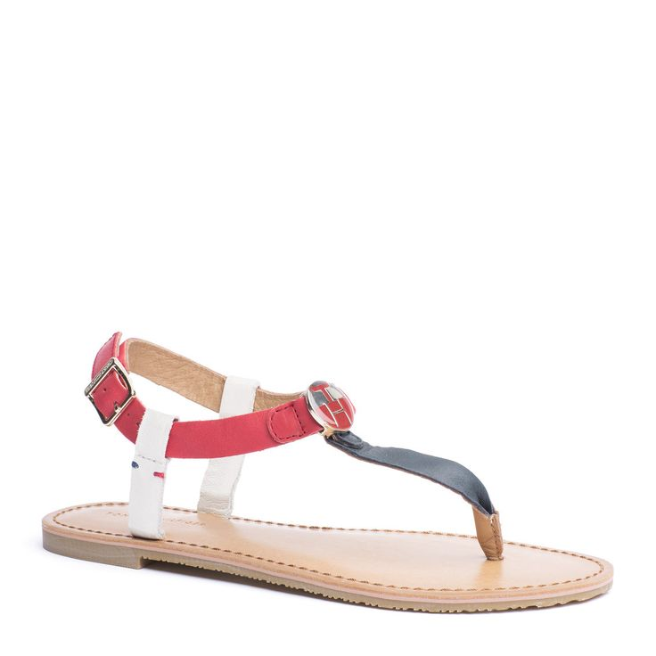 Flat sandals are a style essential. Soft leather upper with gold-toned hardware throughout for a trend-perfect look. Striped side straps depending on your colour choice. Elegant Tommy Hilfiger logo initials at the top of the T-strap, signature twin stitch below the branded buckle on the ankle strap. Leather lining and sock lining with embossed logo at the heel. Rubber sole.
