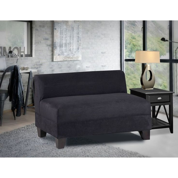 This low-back black loveseat exudes style and sophistication. You will love curling up in its plush material and the superior comfort of its poly-foam fill. The loveseat can be combined with other Makenzie products to create a wraparound sofa.