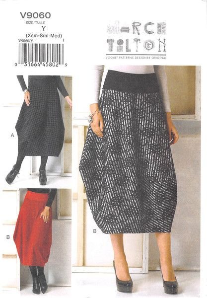 Pull-on skirt has fold-over waistband variations, seam detail and stitched hem. Topstitching. Note: skirt can be worn front to back and back to front.
