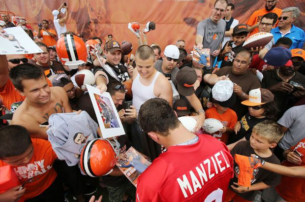 Cleveland Browns quarterback Johnny Manziel signs autographs July 27, 2014, during day two of training camp in Berea. (John Kuntz / The Plain Dealer)