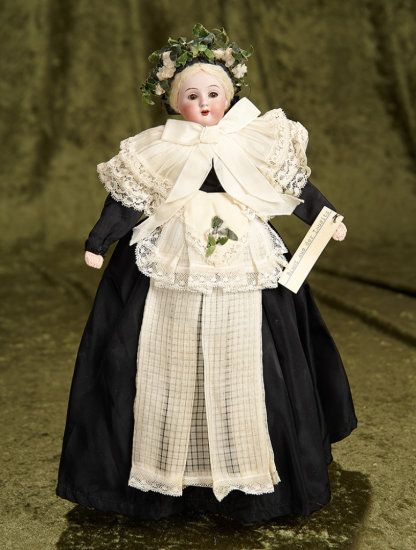 "12"" German bisque doll in original bridal costume of Lausitz~~~ Germany, circa 1890, the doll is wearing an original sewn-on elaborate gown of black taffeta, wide pleated double collar with lace edging, sash, undergarments, and beautiful coronet. An old attached paper label reads "" Braut aus der Lausitz"" (Bride from Lausitz)."