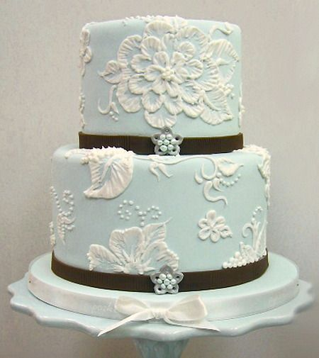 By Chelsea Anderson    This one was done over fondant, but brush embroidery can also be applied over regular icing. You pipe the outlines of your design, and then use a wet brush to drag the lines inward. It sounds simple, but getting it to look as beautiful as this takes bucket loads of skill and patience.    You don't have to have these kinds of cakes only for weddings.... do you?!