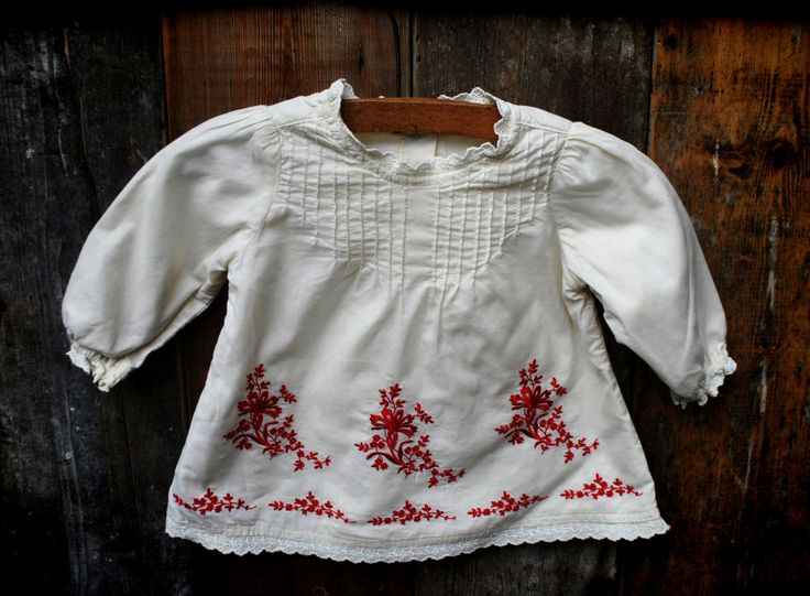 1960s vintage white smock with red embroidered detail. Baby age 6-9 months