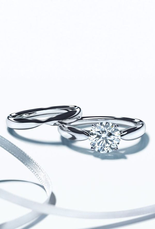 simple elegant round cut diamond wedding engagement rings set--I like the shape of the bands