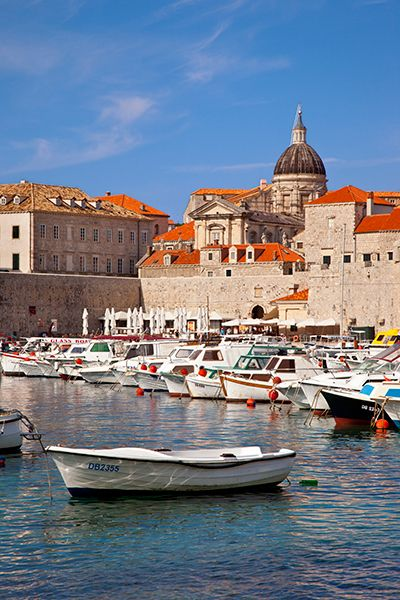 Harbor of Dubrovnic, Croatia. The old port, steeped in history, was where commercial  and maritime activity were carried out until the 1500's.  It was constructed in the 14th century with the tall St John fort defending the port entrance. To protect the city there have been a lot of modifications to the port over the centuries.