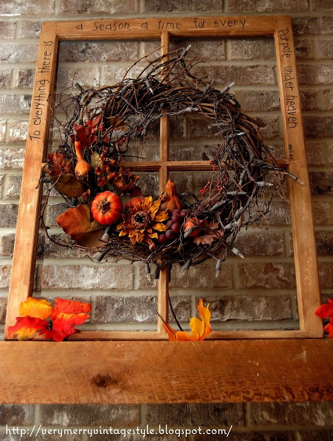Autumn Grapevine Wreath Hanging on a Vintage Glassless Wooden Window Frame With
