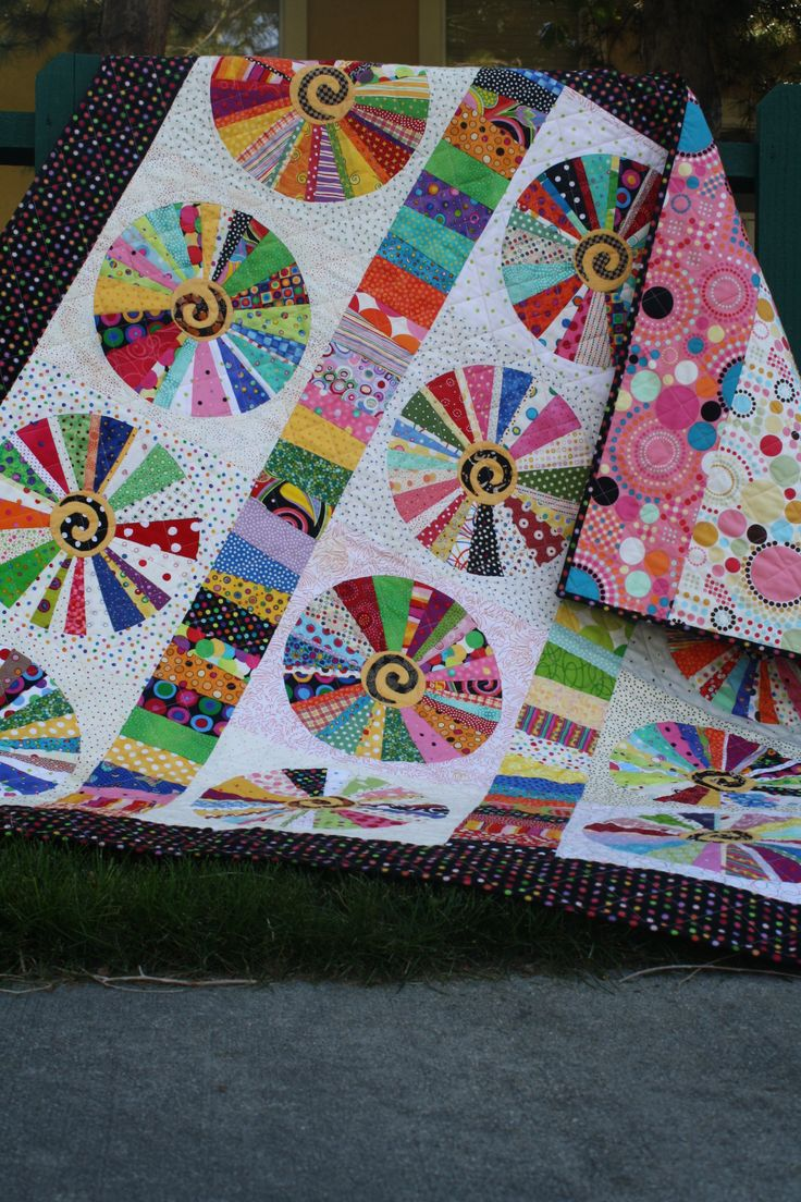 Dots & Circle  all fabric are bright dots.  group  members each made a block for me.  Fun quilt by Carol Day