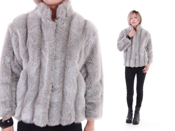 This perfect gray faux fur jacket is thick and soft with hidden flexi hook loop closures and side slit pockets. High collar, great length, this is
