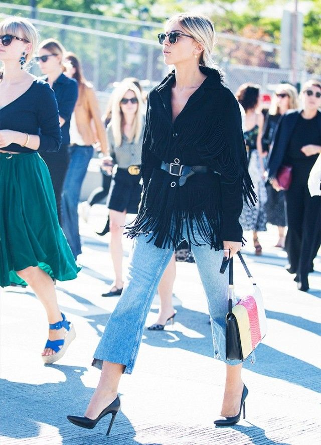 Cropped Flares are worn with black pumps and a belted black fringe jacket.