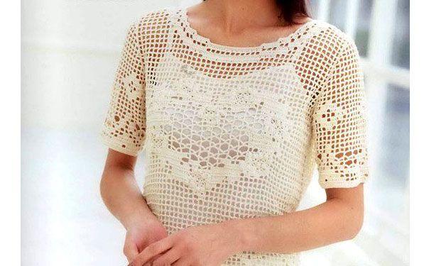 Tricoté blouse avec un motif de «cœur».  régime de tricotage
