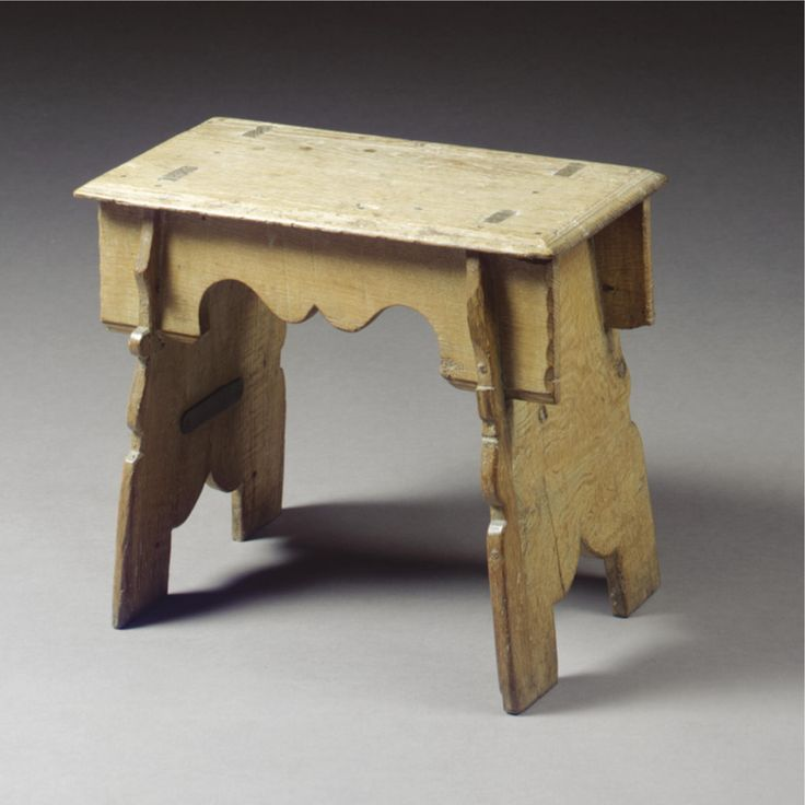 A BOARDED STOOL, ELIZABETHAN Oak, Of Trestle Form, With Moulded Seat And  Shaped