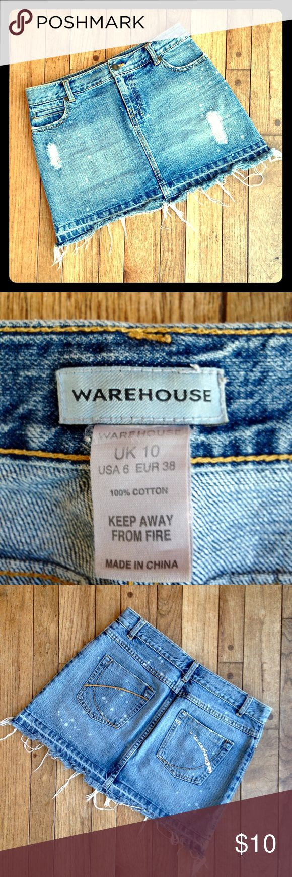 """Warehouse U.K. Distressed Jean skirt w/broken hem W-31. L-14"""". Medium wash with lots of distressing, fading, bleached spots. Broken hem with strings hanging down. I wish this still fit me!  I loved wearing it in the summer when my legs were tan!  Sparkly rhinestones on one pocket.  Quite a few are missing. ☹️ Warehouse UK Skirts Mini"""