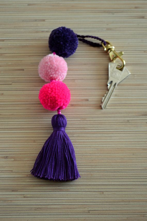 Pom pom keychian Purse charm Tassel keychain Pom pom bag charm Handbag charms Tassel bag charm Pom pom key chain Pom poms tassels Boho Gypsy  Colorful bag charm / key chain made of hand crafted pom poms and tassels. Available in many different colors.  ♥ Heartmade item ♥  All my products come in a nicely crafted wrapping, so they are ready to be given as gifts.  Every piece of jewelry is made in a smoke and pet free environment.  Orders will be mailed by registered and insured internatio...