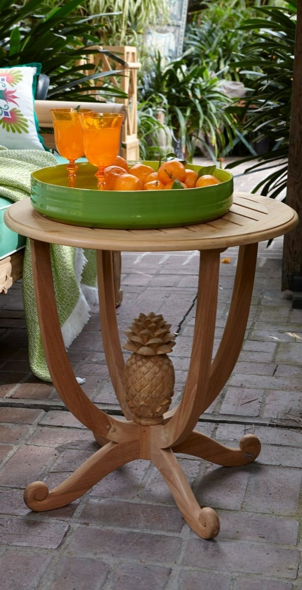Our pineapple side table is underscored by a harp shaped for Pineapple outdoor decor