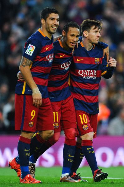 Neymar (C) of FC Barcelona celebrates with his teammates Luis Suarez (L) and Lionel Messi of FC Barcelonaa after scoring his team's third goal of FC Barcelonaduring the La Liga match between FC Barcelona and Real Sociedad de Futbol at Camp Nou on November 28, 2015 in Barcelona, Catalonia.