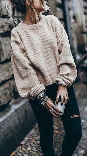 Comfortable, oversized knit sweater with trendy used-look jeans.