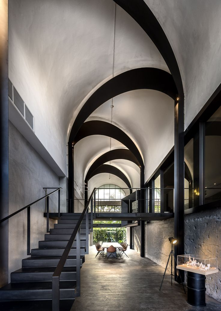 Alternating arches distinguish architecture firm Park + Associates Pte Ltd. offices at Kim Yam Road.