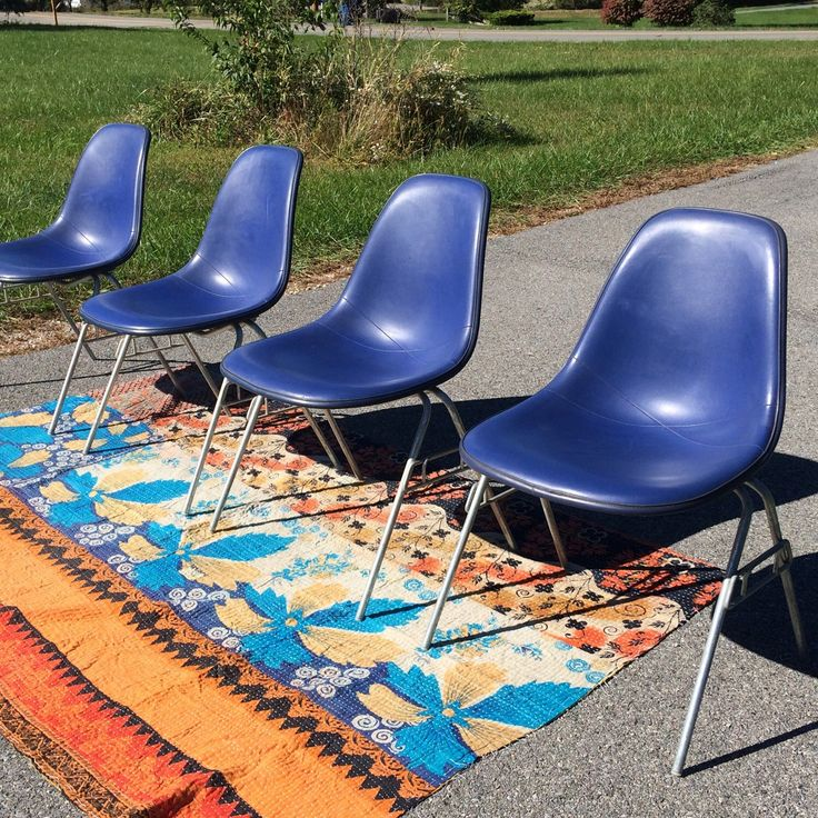 Just added!  Beautiful Med Blue Fiberglass shells on stackable base set of 4.  Features cobalt Naugahyde upholstery.  Made be Herman Miller, designed by Charles Eames.  The quintessential mcm design for you dining room. They are beauties!