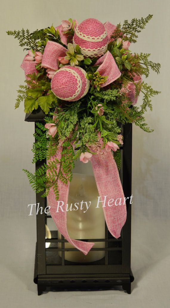 Our lantern swags are great way dress up any lantern! This swag is decorated with pink burlap ribbon, Easter eggs, and various greens. They are