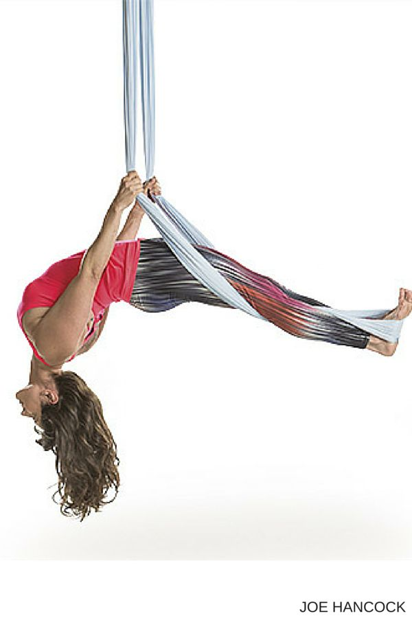 Aerial yoga combines acrobatic arts and anti-gravity asana, but it's also an accessible practice that can help you find more length in your spine and safe alignment in your poses.