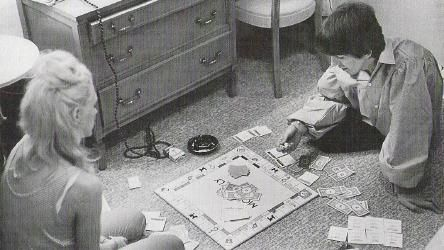 Beatle George Harrison and singer Jackie DeShannon playing Monopoly while on…