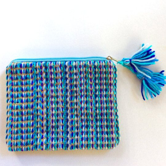 Woolen clutch embroidered with shades of blue and by Apopsis