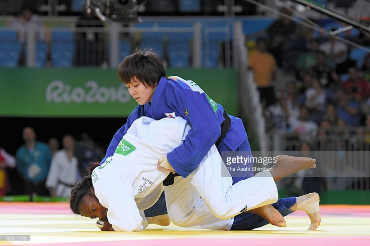 Miku Tashiro (blue) of Japan and Clarisse Agbegnenou (white) of France compete in the Women's -63kg semifinal on Day 4 of the Rio 2016 Olympic Games at the Carioca Arena 2 on August 9, 2016 in Rio de Janeiro, Brazil.