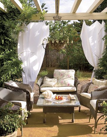 small patio with white linen drapes