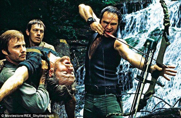Jon Voight, Ronny Cox, Bill McKinney and Burt Reynolds in the film...