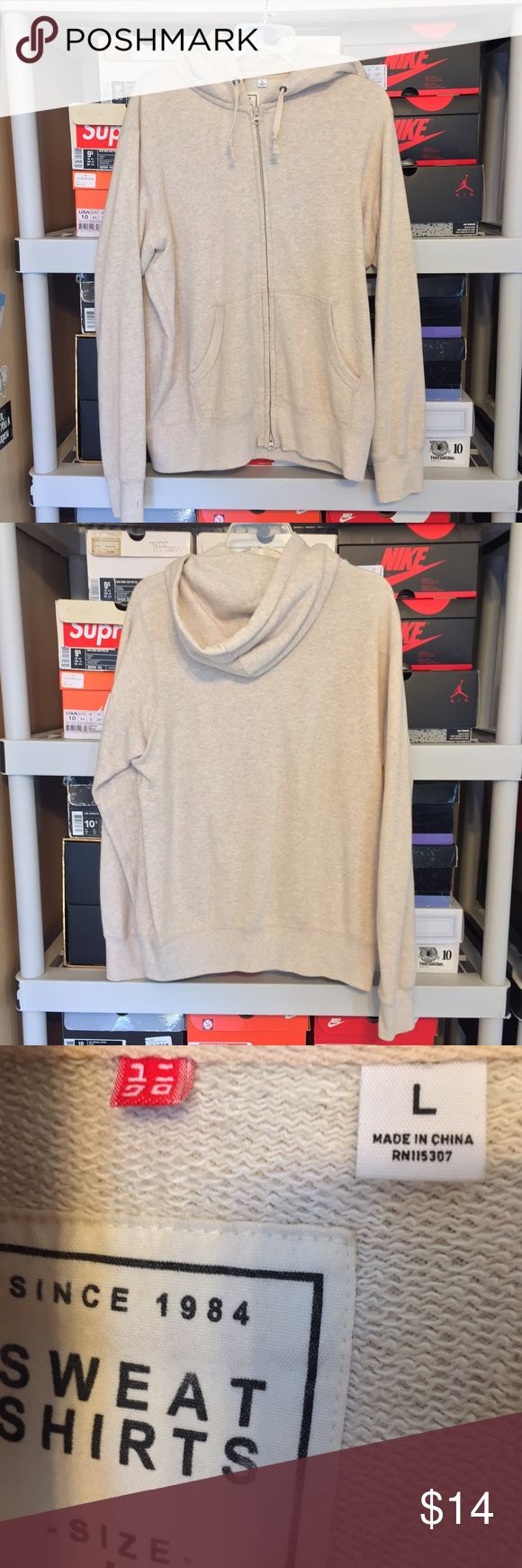 Mens Uniqlo Beige Zip up Hoodie Size Large Mens Uniqlo Beige/Offwhite Zipup Hoodie  This sweater is preowned but in good condition! The only flaw is a small pull/hole in the front as shown in photos.   Size large Uniqlo Sweaters Zip Up