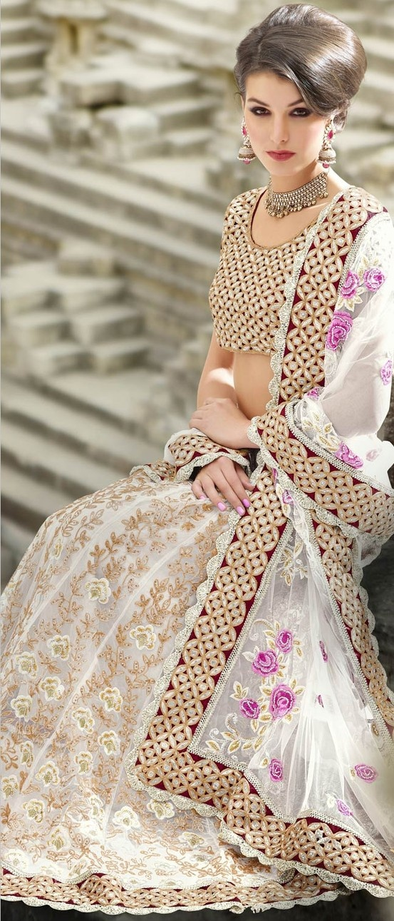 Off White Net #Lehenga with Choli or blouse and Dupatta. Statement earrings and necklace. #IndianFashion