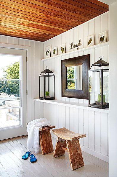 The entry features a pair of wall length floating shelves. The upper shelf  is adorned  White Painted Wood FloorsWhite ...
