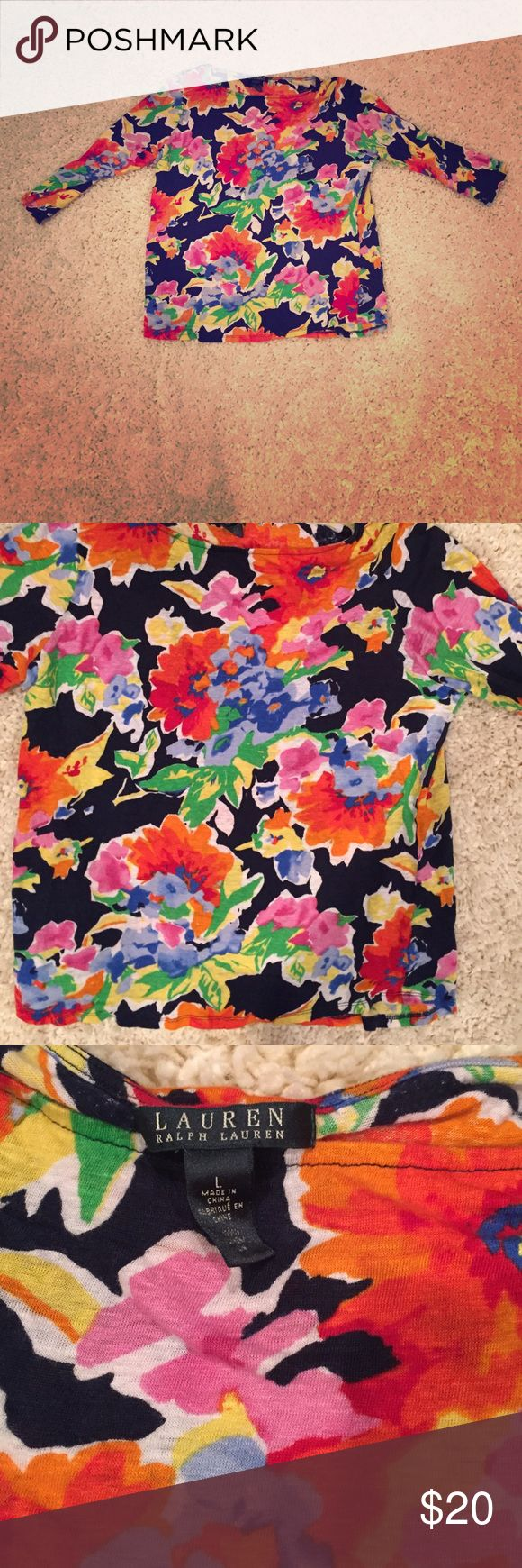 Gorgeous Woman's 3/4 Sleeve Floral Top This is a beautiful woman's 3/4 Sleeve Floral top. It is in excellent new condition and was worn once. There are no tears, holes or stains  It is a woman's large and is 22 inches from the top of the shirt to the bottom and 20 1/2 inches armpit to armpit. It is stretchy as well. Lauren Ralph Lauren Tops