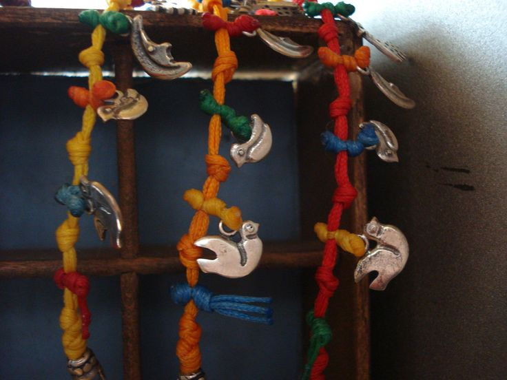 handmade bracelets of silver 926 elements with waxed cords
