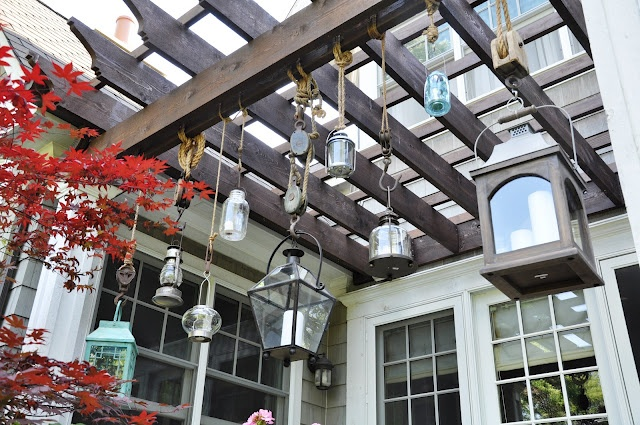 love this different styles & sizes of lanterns hanging at different lengths:  Serendipity Refined: Pottery Barn Inspired Patio Lantern Project