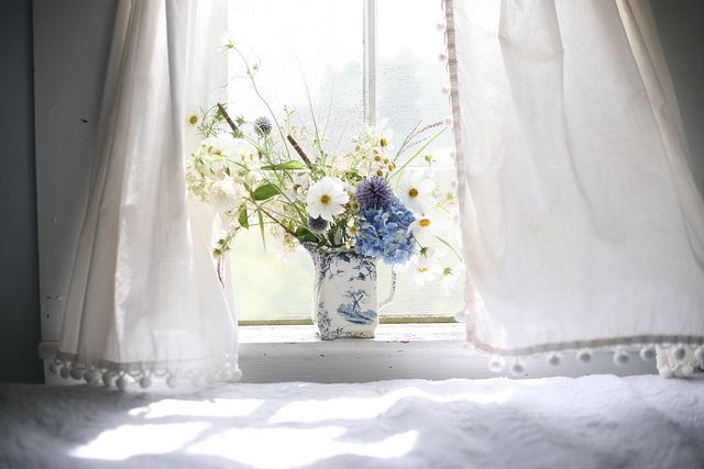 Home interior decorations -fresh blue flowers by the window
