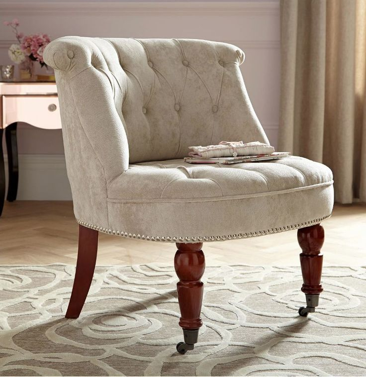 """This model is a Designer Bedroom Chair, in luxurious soft chenille fabric, thickly padded buttons and chrome stud detail. Width: 67cm Depth: 62cm Height: 72cm Height to seat: 40cm. nuff said"""". 