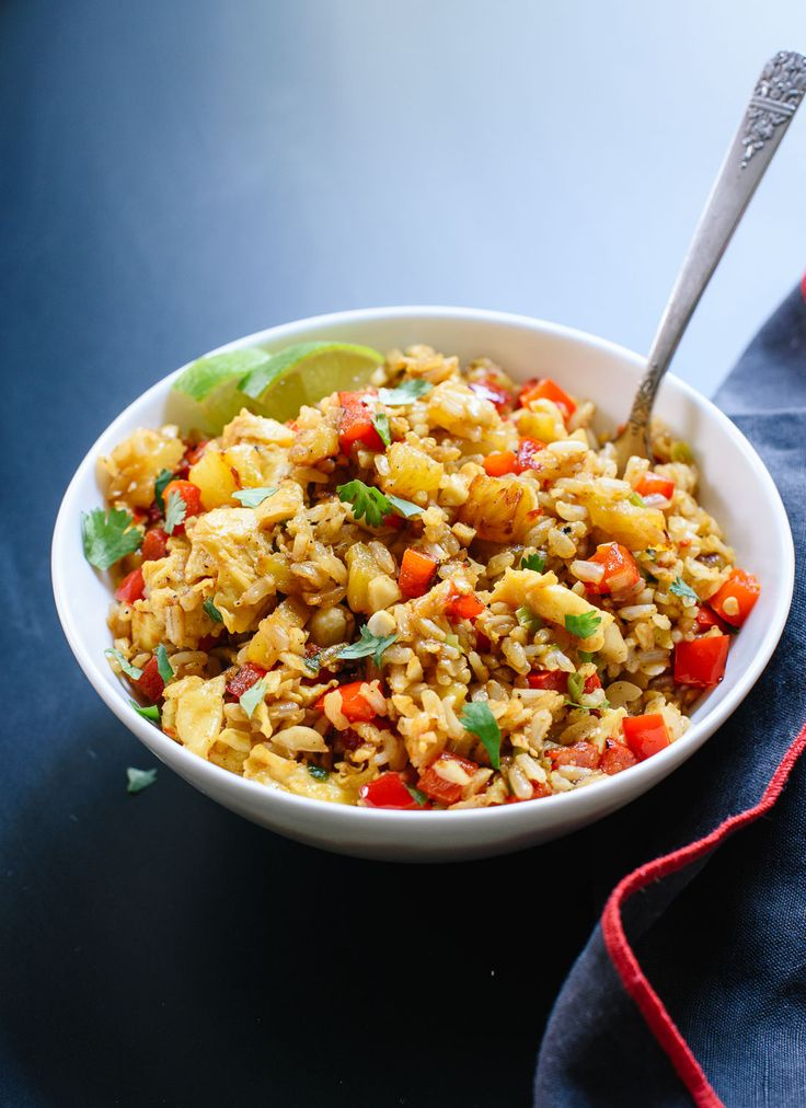 Thai-style sweet and spicy pineapple fried rice with scrambled eggs and cashews. This is a healthy and quick weeknight dinner! So much better than take-out.