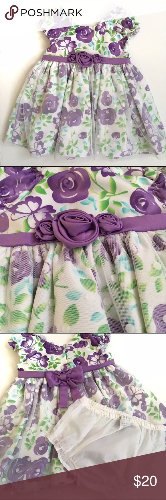 NWOT Formal Spring Dress NWOT Formal Spring Dress. Purple flowers and green leaf design. Shirt has a white polka for tulle overlay. elastic inseam on shoulders to ensure Dress stays put. Purple sash with bow on back with snap button closure. Also come with diaper cover. Dresses Formal