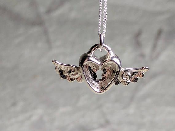 Winged heart locket pendant, sterling silver, card captors inspired, dainty everyday jewellery https://www.etsy.com/uk/listing/552275481/winged-locket-pendant