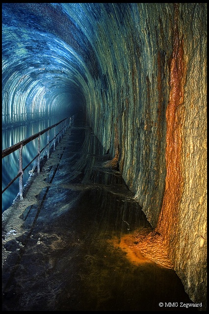 Wow. If the spirit of dark and lonely water lives anywhere, it's here. Canal tunnel, Belgium