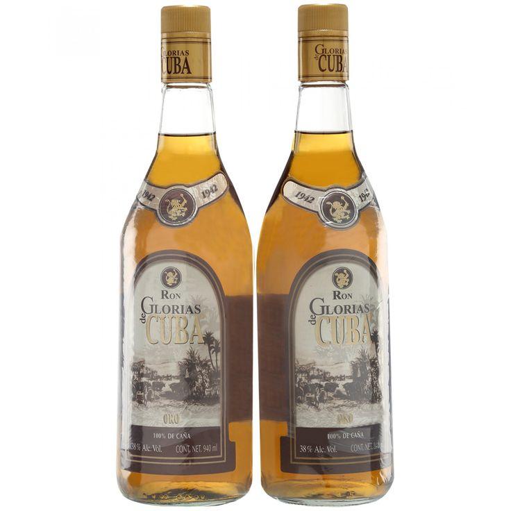Set Ron Glorias de Cuba con dos botellas de esta bebida madurada en las clásicas barricas de roble bajo condiciones de luz y temperatura controladas con el más intenso cuidado; de brillante color ámbar con ciertos tonos cobrizos complejo y fino en nari