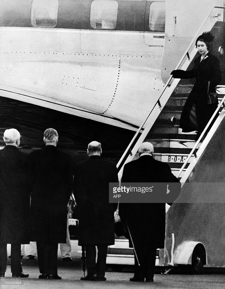 Queen Elizabeth II of England gets off plane, greeted by (from R to L) Sir Winston Churchill, Clement Attlee, Anthony Eden and Frederick James Marquis, 1st Earl of Woolton and Lord President of the Council, 08 February 1952, as she returns from Kenya. Queen Elizabeth II was proclaimed Sovereign of each of the Commonwealth Realms on 06 February 1952, after the death of her father King George VI in the night between 05 February and 06 February 1952. Princess Elizabeth heard the news of her…