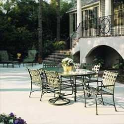 """Seville Dining Groups - 74"""" Oval Dining Table with 4 Dining Chairs & 2 Swivel Rockers - Aluminum Patio Furniture by Woodard. $2039.00. Aluminum Patio Dining Groups - 74"""" Oval Dining Table with 4 Dining Chairs & 2 Swivel Rockers. Visit our site for Strap Color and Aluminum Finish options. Curvy and classic, Seville melds the durability of virgin vinyl straps with a hand wrought powder coated rustproof aluminum frame to create the ideal outdoor furniture. Available in ei..."""