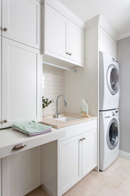 Cabinets?  Laundry room using White glass subway tile. Gorgeous, modern, laundry room!! https://www.subwaytileoutlet.com/products/White-Glass-Subway-Tile.html#.Vd3vj_lViko